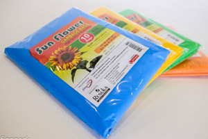 Folded charity bags and retail packs